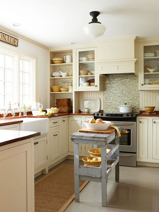 Dark color schemes shrink an already small space and make it less inviting. Use soft shades on kitchen cabinets and natural light to visually expand a small room. BUT... if you want a warm cozy kitchen and yours is small, then go for the warm wood tones - sometimes getting what you love means breaking the rules!