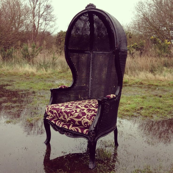 A One Off Grand Black Wicker Chair With Deep Purple Upholstery. It Stands  At Tall And Wide. It Has A Pod Like Hood With Ornate Detail. Best Suited To  Photo ...