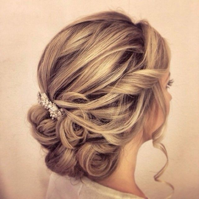 updo wedding hairstyle; via Websalon Weddings