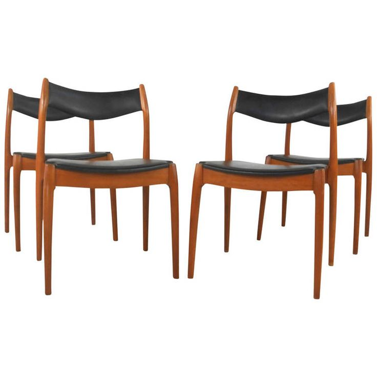 Set of four mid century danish teak dining chairs from a for Unique modern dining room sets