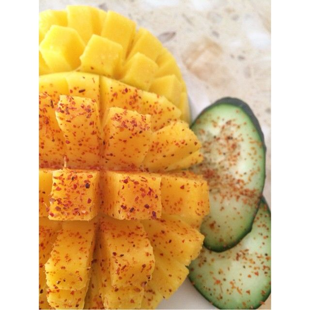 Two of our favorites with a sprinkle of #Tajin. #mango #cucumber