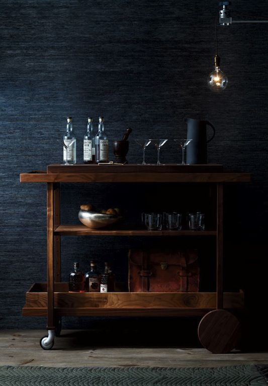 Very nice dark blue grey. I really enjoy how this picture is styled - that wooden trolley constrasts nicely with the wall and the lightbulb give a little pop of eccentricity.