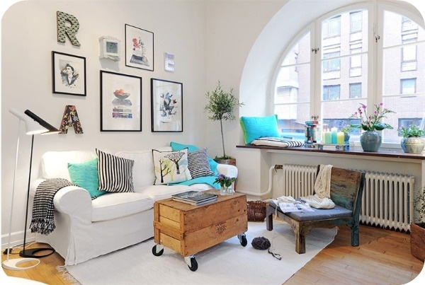 love the stripes.. that awesome arched window.. the cute coffee table