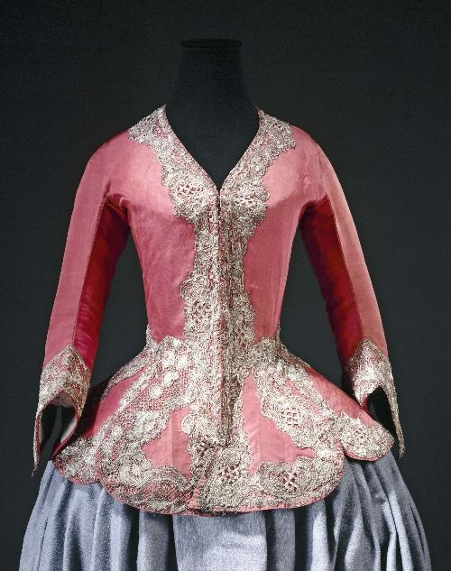 CASAQUIN, c1730-1740 Gros de Tours, orange silk, blue glazed linen lining, gilded silver lace.Acquired by the City of Paris Palais Galliera, musée de la Mode de la Ville de Paris. Casaquin: close-fitting coat w /long basques often appears in female portraits containing references to the hunt; however, its elaborate ornamentation suggests rather the festivities of the return from the hunt or semi-ceremonial events like meals or walks in distinguished company.
