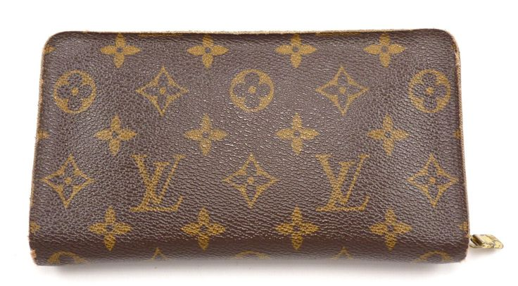 CONDITION: Very Good Pre-owned (condition chart) GUARANTEED AUTHENTIC COLOR: Brown LOUIS VUITTON MEN'S MONOGRAM CANVAS ZIP BI-FOLD WALLET FEATURES & MATERIALS - Made of coated monogram canvas. - Holds