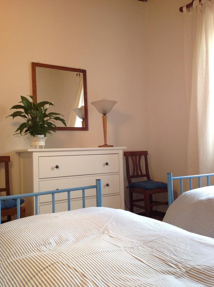 Camera da letto dell'appartamento al piano terreno