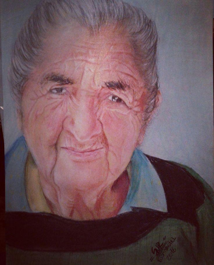 Retrato pintando con lápiz pastel duro de 27x37cms