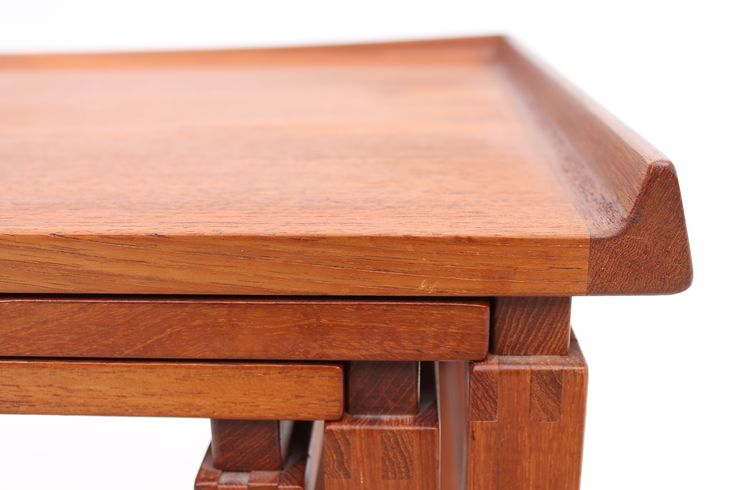 Set of nesting tables in teak. Curved lift and solid joinings. Designed and produced in Denmark in the 1960s. www.reModern.dk