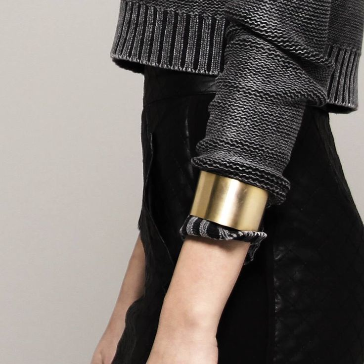 Clever way to roll up sleeves and keep bracelets from constantly moving around