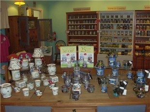 Country Charm - Looking to spice up your home with a Yankee Candle scent or add a touch to the outside of your home with a flag? Looking for that perfect piece of jewelry? Look no further…Make Country Charm your LOCAL one-stop-shop for gifts, tanning, unique apparel and much more!!!