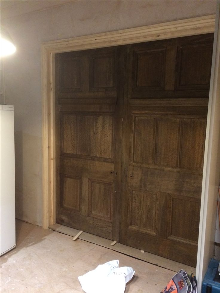 Reclaimed Oak doors from Wells Reclamation. Hung on large brass parliament hinges so they swing right back.