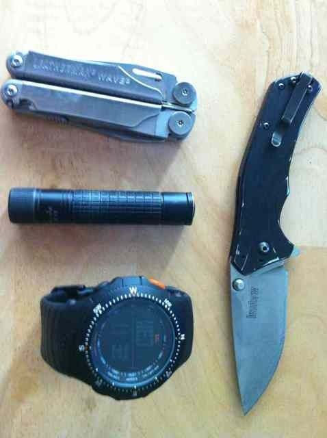 Leatherman Wave multi tool, Fenix E11 flashlight, 5.11 Field Ops tactical watch and Kershaw Knockout knife.