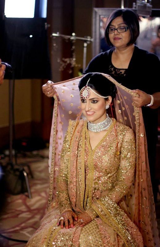 Sikh Wedding Brides - Pastel Peach Lehenga with Gold Sequins work all over, Double Dupatta, Net Dupatta with booti work | WedMeGood #wedmegood #sikh #brides #sequins