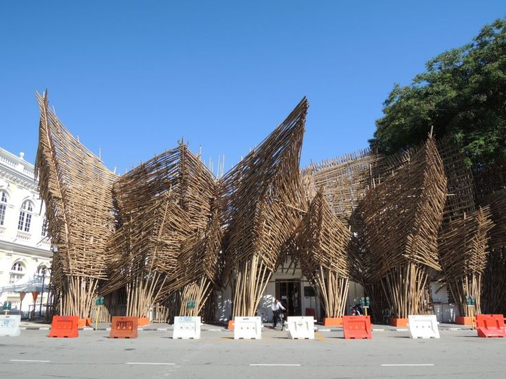 """Joko Avianto's """"The Theater of Ships"""" is the main giant visual treat in George Town Festival (GTF) 2013. Situated between the iconic town hall and city hall, a municipal office gets a new radical exterior look with a facade consisting of around 3,000 bamboos. We are delighted to get the opportunity to enjoy this intricate design on the first day of GTF. The month-long festival stages a plethora of art works and cultural exhibitions across the city."""