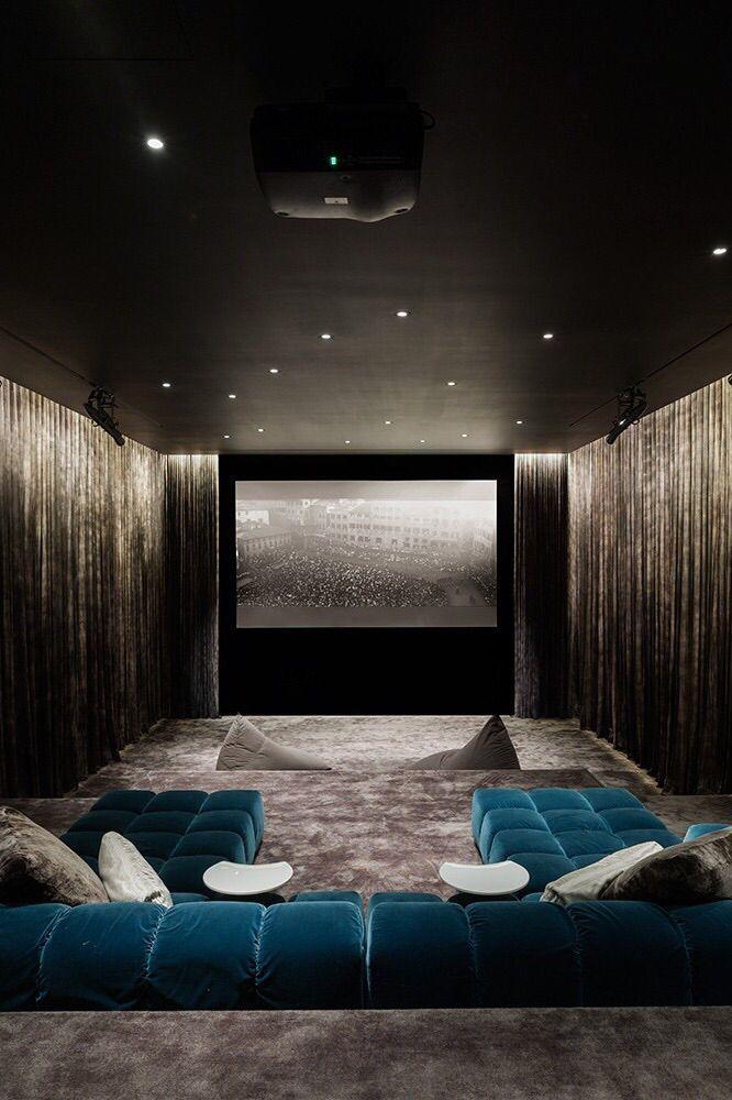 Sleek drapery-wrapped home Theater