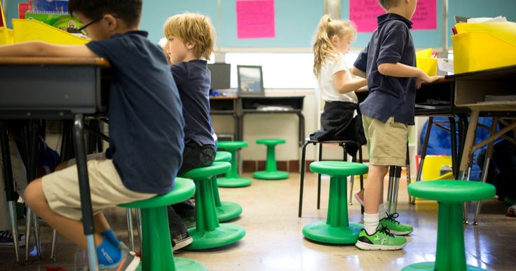 Peek inside Jennifer Cass' second grade classroom and you won't see kids sitting on desk chairs in rows. Some gently bounce on stability balls....