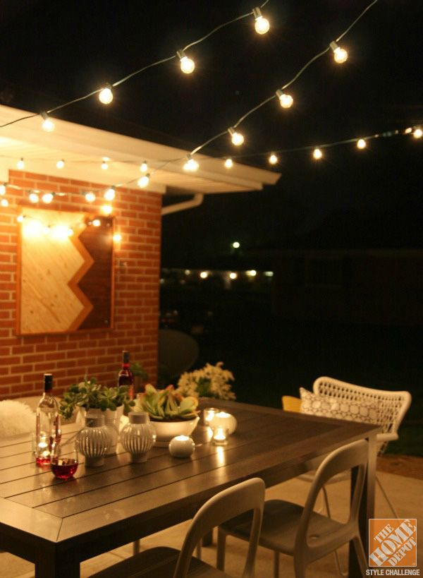 A Family-Friendly Outdoor Dining Space by House*Tweaking Restaurant, Lighting and String lights