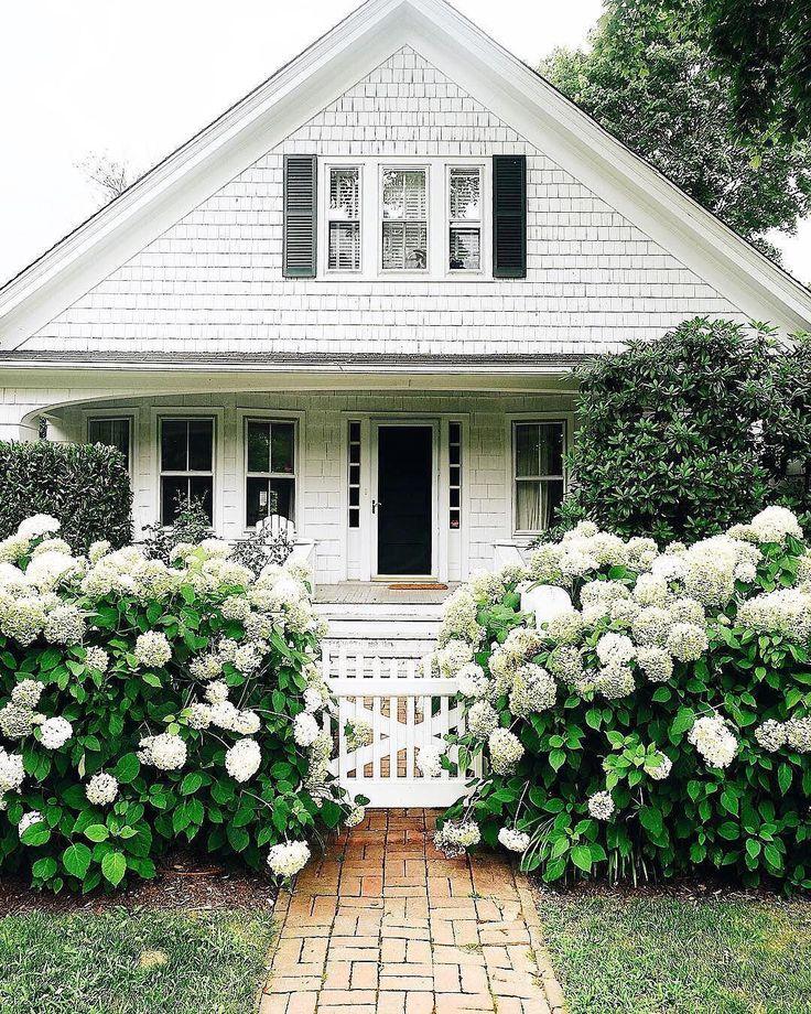 white exterior | picket fence | white flowers
