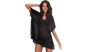 Get ready for summer and look the part while walking on the beach wearing the black beach cover up with side slits
