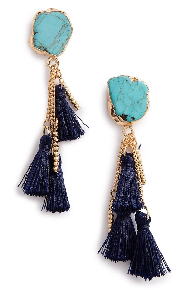 Soft tassels dangle from eye-catching, marbled stone earrings in glinting goldtone or silvertone plating.