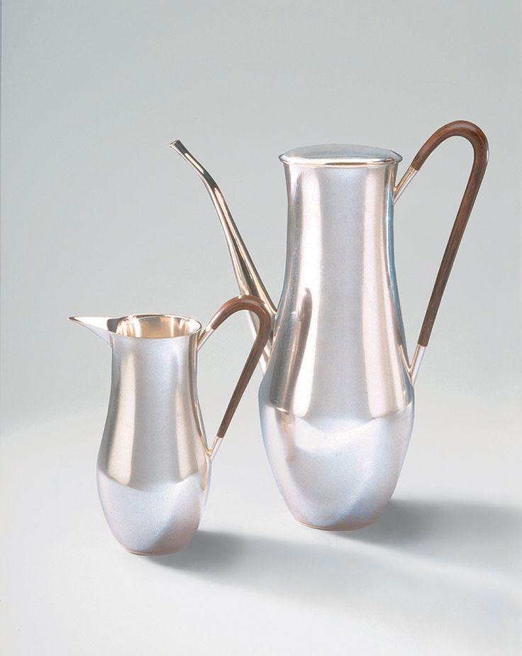 Silver Coffee Pot and Milk Jug with Rosewood Handles. Designed and made by David Mellor in 1950. Now in the Worshipful Company of Goldsmiths collection. #handmade #sterlingsilver #silver #coffeepot