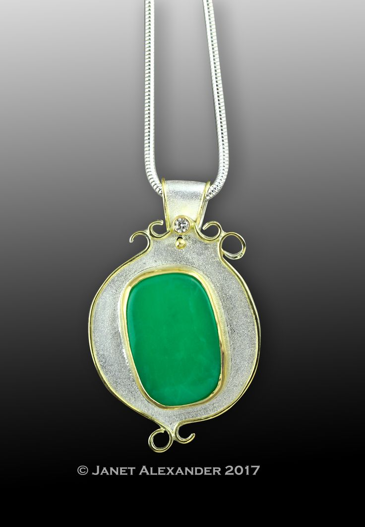 """140ct Chrysoprase green stone with 2.7mm .07ct,   G - H, I3,diamond, accented with 18k gold. Hangs on 18"""" sterling silver snake chain."""