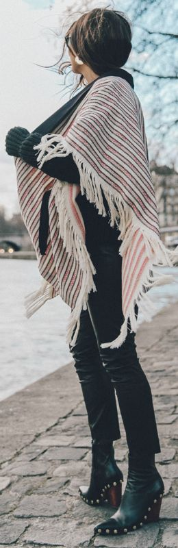 Sara Escudero + gorgeous striped poncho + frayed detail at the seams + easy and stylish spring look + studded boots + authentic style  Poncho: Majexclusive Edit 8, Jersey: Sales, Leggings: Reiss, Booties: Celine.
