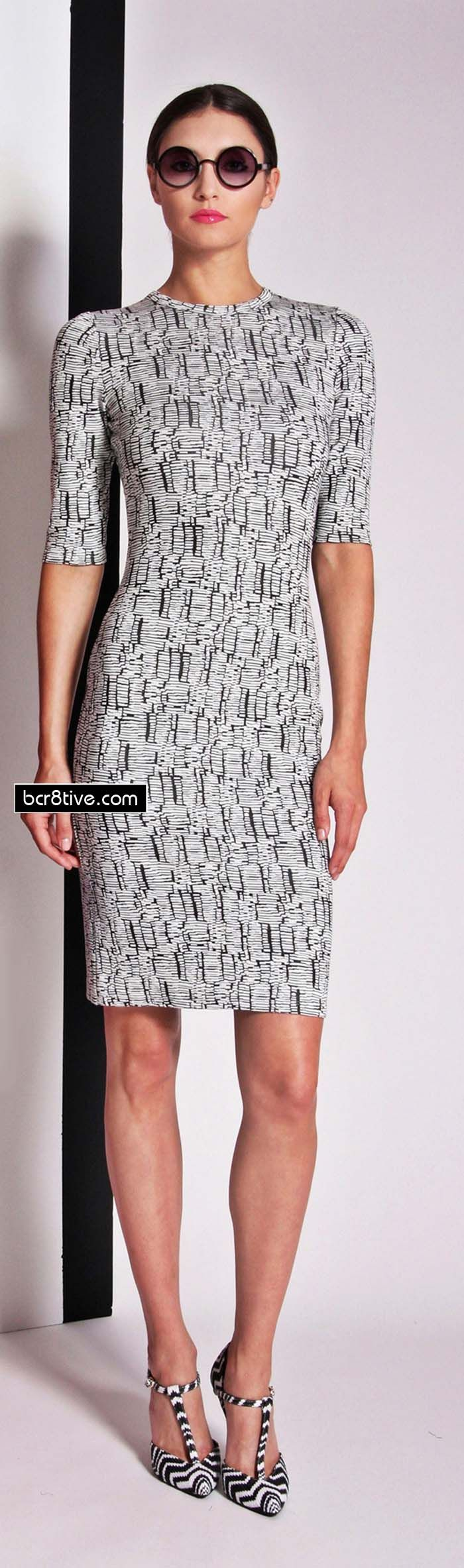 Subtle black and white print on a shift/sheath dress. Round neck and elbow length sleeves. Christian Siriano Resort 2014.