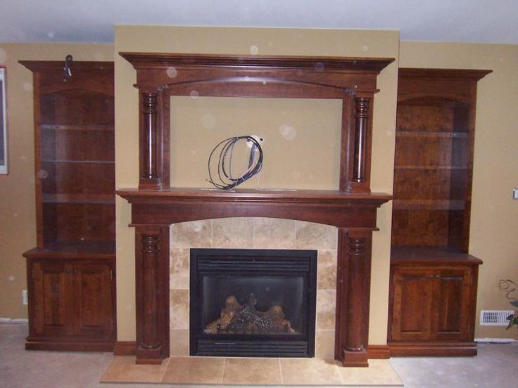 do i want that much wood color or more white faux fireplace with bookshelves ideas