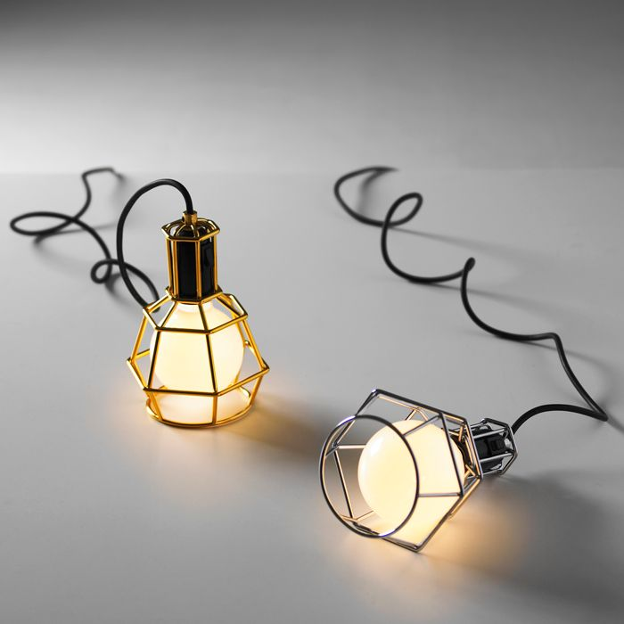 Jonas Pettersson, John Lofgren and Petrus Palmer--refined the lowly utility light into something beautiful with a few new bends of the angled cage, a dimmer switch to match your mood, and thickening those wires by plating them in chrome or gold.