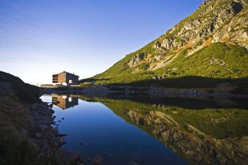 Horsky Hotel Sliezsky Dom Tatranská Polianka Horsky Hotel Sliezsky Dom is located in the heart of Tatra Mountains, 1670 metres above the sea level. It offers elegant rooms with mountain views, a flat-screen TV and a minibar.