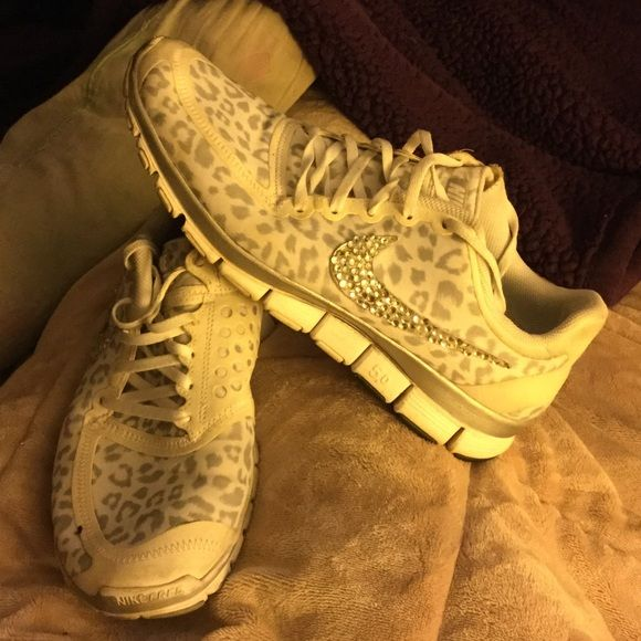 Nike leopard bling sneakers 10 These are used but very cute shoes...got tonssss on compliments.....they size 11 but if you have ever tried this style on you know they run one size small..so they fit a size 10 perfect. Nike Shoes Athletic Shoes