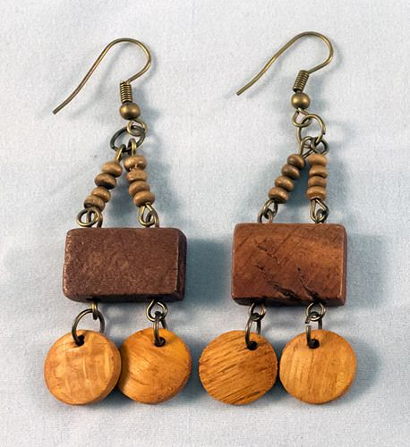 These are gorgeous wooden earrings made of one main wooden brick with two smaller discs. The earrings measure at 5 cm.