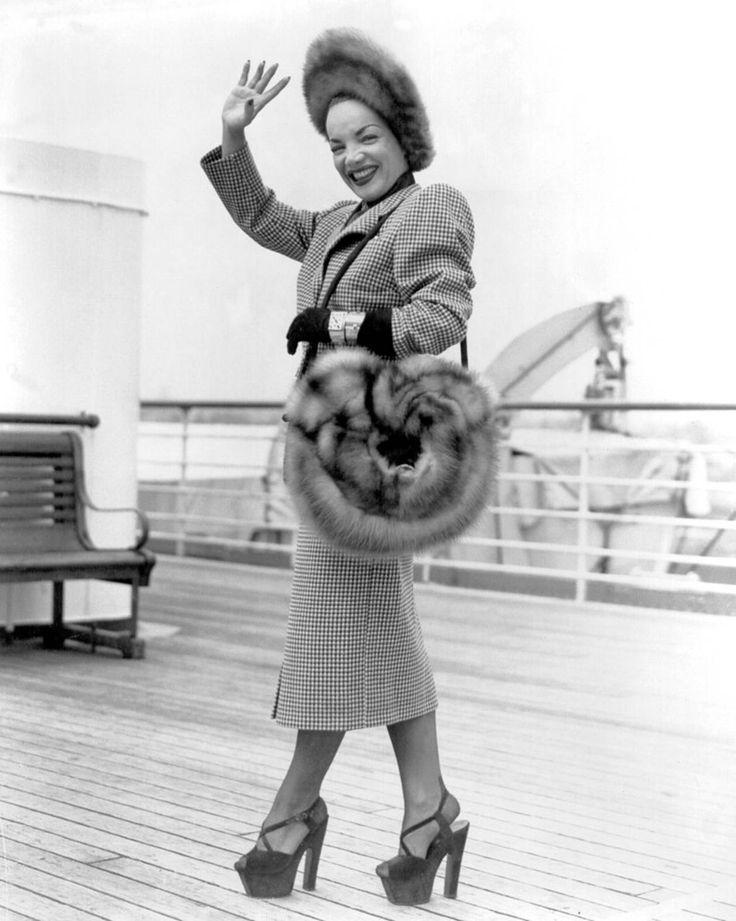 Carmen Miranda wearing signature platforms but not the towering fruit headdress!