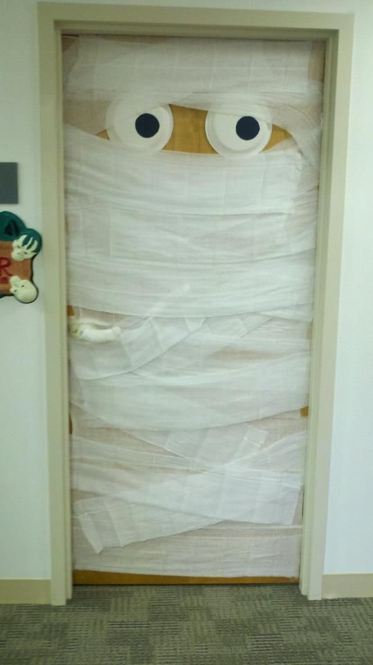 Halloween Office Door Decorating Contest -- Mummy made from cheesecloth and paper plates for eyes.