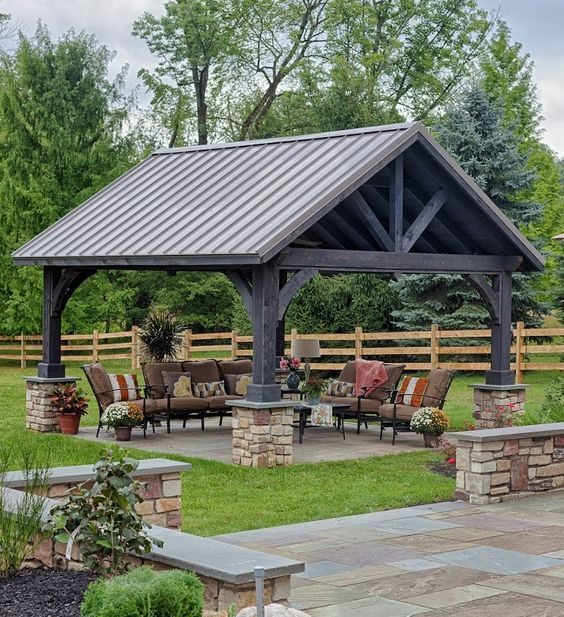 Alpine Cedar Pavilion with Stain and Standing Seam Metal Roof http://www.backyardunlimited.com/pavilions.php: