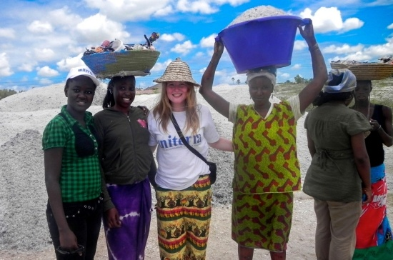SFU undergrad Leah Bjornson (centre) with Senegalese student Fanta (far left) and salt workers at Lac Rose, a lake in Senegal that produces huge amounts of salt the women collect and dump in mounds along the shore.