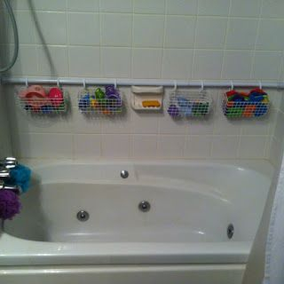 Organizing the storage within the shower stall!  I saw this and thought...this might work in my little 4x4 shower, to hold all my shampoos and conditioners, etc.    Place a spring-loaded shower rod against the back wall of your tub, with wire baskets hanging on shower curtain hooks to organize all those bath toys.    I think any sort of basket would work, either wire or plastic baskets.