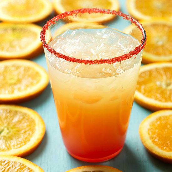 Tequila Sunrise Margarita - Enjoy two drinks in one by adding tangy orange juice and a touch of grenadine to traditional margaritas. More margarita recipes: http://www.bhg.com/recipes/drinks/wine-cocktails/margarita-recipes/