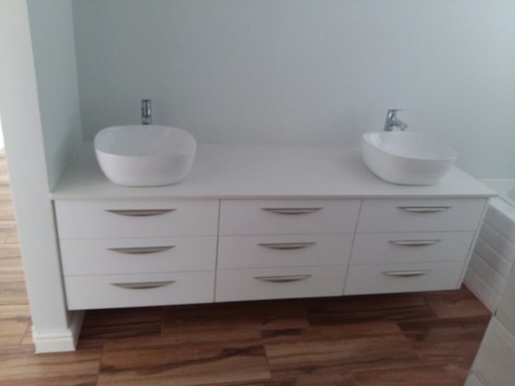 Custom bathroom vanity, white duco and eaziquartz top.