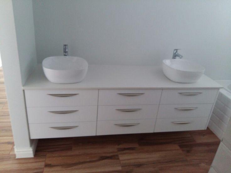 Custom bathroom vanity, white duco and eaziquartz top.