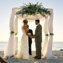 bridal arch.  too much with an outdoor wedding? or a nice symbolic touch, in place of a church altar...