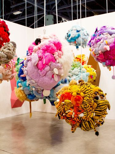 //Mike Kelly-  series of sculptural pieces using children's stuffed animals sewn onto or covered over with hand-knitted afghans.