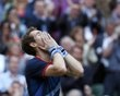 Britain's Murray reacts after winning his men's singles tennis semi-final match against Serbia's Djokovic at the All England Lawn Tennis Club during the London 2012 Olympic Games