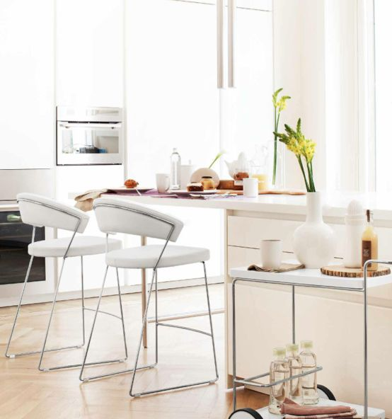 Perfect clean white, this is the ideal dining decor from Eclectic Elements!