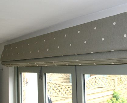 moghul roman blind on cedar bifold doors