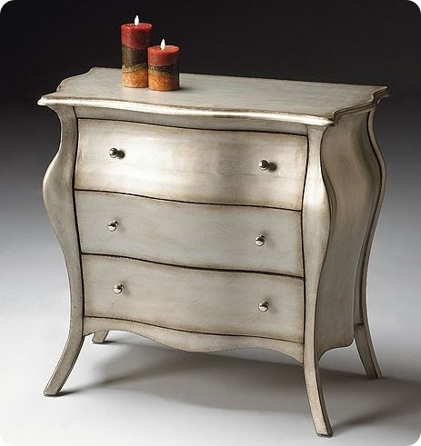 metallic furniture... who knew, but i love it. I've decided to make my nighstands metallic instead of buying new ones!