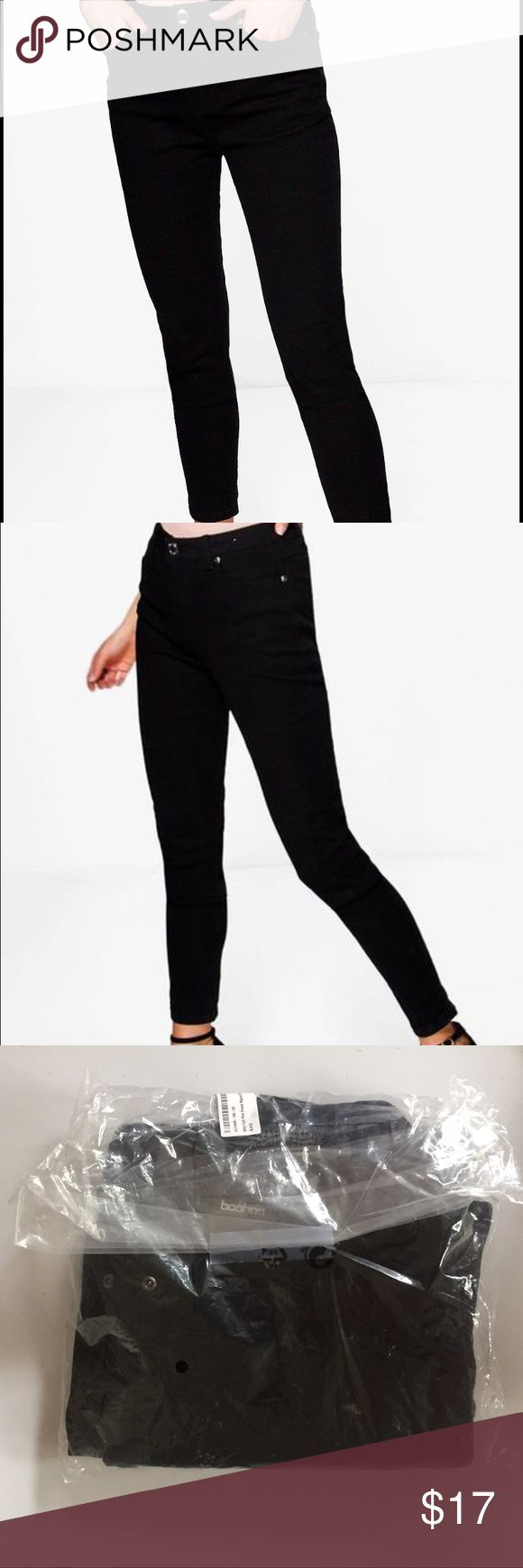 Black Skinny Jeans Never Been Worn. BRAND NEW. Jess Mid Rise 32' Leg Skinny Jeans. Still in original packaging. Size 12. Boohoo Jeans Skinny