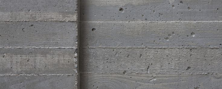 A board form finish is achieved by casting thin concrete How to finish a concrete wall