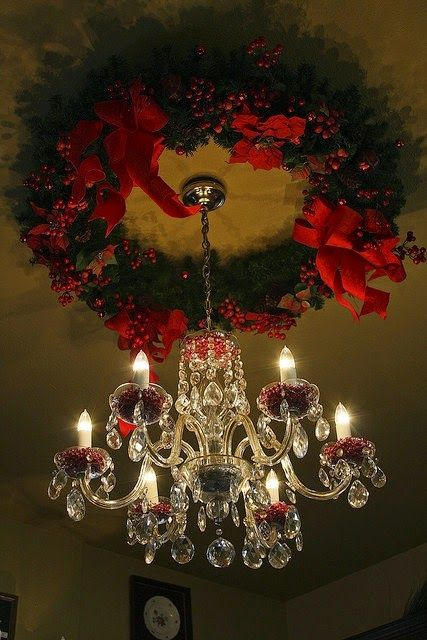 Christmas Wreath and Chandelier | Christmas Season. I think those are cranberries inside the chandelier globes.